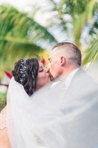 Destination Wedding Couple Veil Swoop